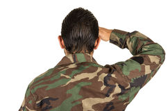 Rear view of man in military uniform saluting. Isolated on white Stock Image