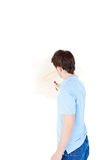 Rear view of a man painting Royalty Free Stock Image