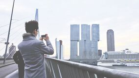 Rear View of Man Photographing Cityscape Royalty Free Stock Photo