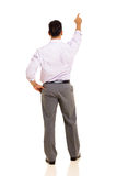 Rear view man pointing Royalty Free Stock Photo