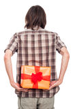 Rear view of man with present Royalty Free Stock Photography