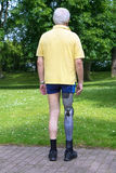 Rear view on man with prosthetic leg Royalty Free Stock Photo