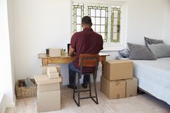 Rear View Of Man Running Business From Home Dispatching Goods stock photography
