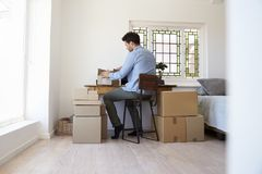 Rear View Of Man Running Business From Home Dispatching Goods Stock Photo