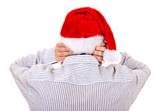 Rear View of a Man in Santa Hat Stock Photo