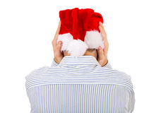 Rear View of a Man in Santa Hat Stock Images