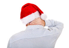 Rear View of a Man in Santa Hat Stock Photography