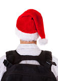 Rear View of a Man in Santa Hat Stock Image
