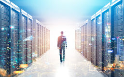 Rear view of man in a server room, city Royalty Free Stock Images