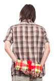 Rear view of man with small present Royalty Free Stock Photo