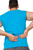 Rear view of man in sportswear suffering from backache Royalty Free Stock Images