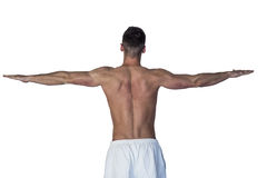 Rear view of a man stretching his arms Royalty Free Stock Photo