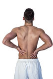 Rear view of man suffering from back pain Stock Photos