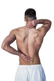 Rear view of man suffering from neck and back pain Royalty Free Stock Photo