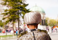 Rear view of a man with sultan`s hat and historical building on stock images