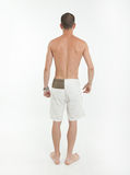 Rear view of man in swimming trunks. Rear view of a young man wearing swimming trunks Royalty Free Stock Photo