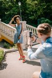 rear view of man taking picture of young african american girlfriend stock image