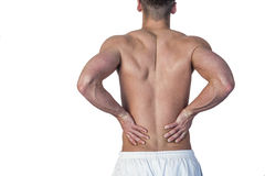 Rear view of a man undergoing back pain Royalty Free Stock Images