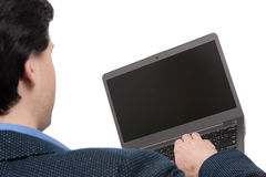 Rear view of a man using laptop Stock Image