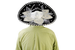 Rear view of man wearing Mexican sombrero. Half body rear view portrait of man wearing Mexican sombrero, white background Royalty Free Stock Image