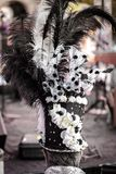 Rear view of man wearing top hat or cylinder hat decorated with feathers during a masked festival stock photo