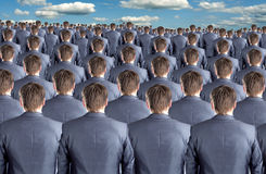 Rear view of many businessmen. Rear view of many identical businessman clones Stock Photo