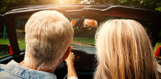 Rear view of mature couple going for ride together Royalty Free Stock Image
