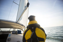 Rear View Of Mature Man Sailing On Yacht Royalty Free Stock Images