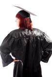 Rear view of a mature student standing with her arms akimbo Royalty Free Stock Images