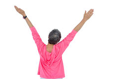Rear view of mature woman with arms raised Royalty Free Stock Photography