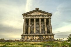 Rear view on the medieval pagan temple, built in honor of the Sun God Mithra in the village of Garni,located near Yerevan. The reverse side of the medieval pagan royalty free stock image