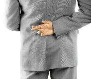 Rear view mid section of a business man with fingers crossed at the back Royalty Free Stock Photography