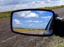 Rear-view mirror. On the cloud stock photo