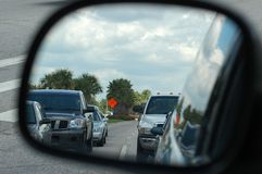 Rear View Mirror. Photographed from a moving car Stock Photos