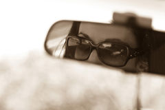 Rear View Mirror. The face of a young woman driving as seen in the rear view mirror Stock Image