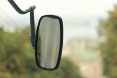 Rear-view mirror on the bus Royalty Free Stock Photography