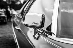 Rear-view mirror of the Cadillac Coupe de Ville. Stock Photography
