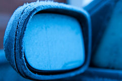Rear view mirror of a car covered with frost Royalty Free Stock Photo