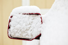 Rear view mirror covered in snow Stock Photos