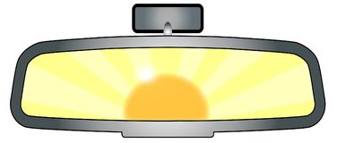 Rear View Mirror Glare. Depiction of a vehicle rear view mirror with the sun glare Royalty Free Stock Photos