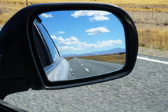 Rear view in mirror. Royalty Free Stock Photos