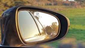 Rear View Mirror. View from the passenger seat, looking backwards royalty free stock image