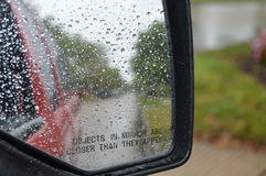 Rear view mirror in the rain Stock Images