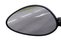 Rear view mirror reflecting road, left side lateral, macro closeup, tarmac asphalt background reflection, white lines, arrows Stock Photos