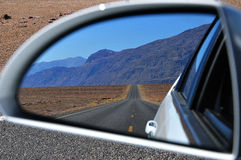 Desert road: rear-view mirror reflection Royalty Free Stock Photography