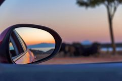 Rear View Mirror Reflection on sun down Royalty Free Stock Photography