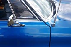 Rear-view mirror of retro car Stock Photo