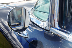 Rear-view mirror of retro car Stock Images