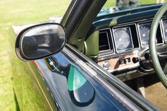 Rear-view mirror of retro car Stock Photo