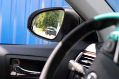Rear-view mirror and steering wheel of the car Royalty Free Stock Photo